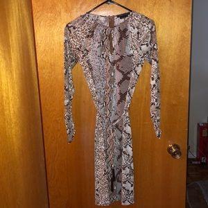Keyhole snake print dress with belt.